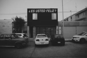 Lugar Común. Intervention by Alfredo Jaar. Estudios sobre la felicidad